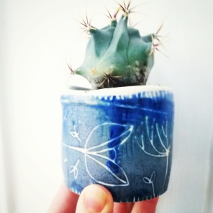 wheel thrown miniature plant pot with sgraffito decoration based on Norwegian folk art motifs. Jensmithceramics