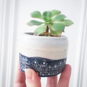 wheel thrown miniature plant pot with sgraffito houses decoration. Jensmithceramics