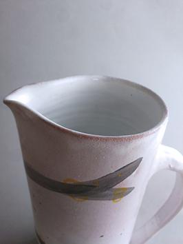 rim of salt white jug with black bladderwrack illustration