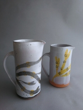 chalk grey jugs with black and ochre bladderwrack illustration
